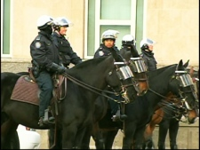 Riot police are on the scene at University Avenue as thousands of Tamils protest in front of the U.S. consulate on April 27, 2009.