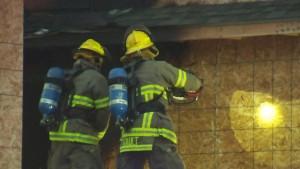 Firefighters investigate a fire at a home on Zeller Drive in Kitchener on Sunday, Oct. 22, 2017.