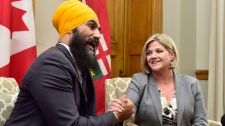 Ontario NDP Leader Andrea Horwath and federal NDP Leader Jagmeet Singh speak with members of the media following their meeting in Toronto on Monday Oct. 23, 2017. THE CANADIAN PRESS/Frank Gunn