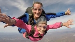 Eila Campbell, 94, falls through the air druing a skydive in Pennsylvania. (Above the Poconos Skydivers / YouTube)