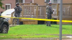 York Regional Police's tactical unit investigate at the scene of a fatal shooting in Newmarket on October 21, 2017.