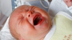In this file photo, a baby cries in its bed in a hospital in Bremen, northern Germany. (AP / Joerg Sarbach)