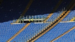 Stewards are seen by empty stands ahead of an Italian Serie A soccer match between Roma and Lazio at Rome's Olympic stadium, Sunday, Nov. 8, 2015. (AP Photo/Alessandra Tarantino)