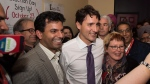 Prime Minister Justin Trudeau poses with volunteers during a visit to Spruce Grove Alta. on Friday October 20, 2017. THE CANADIAN PRESS/Paul Swanson