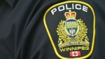 A woman had her purse stolen off her shoulder Sunday morning in the West End, Winnipeg police said.