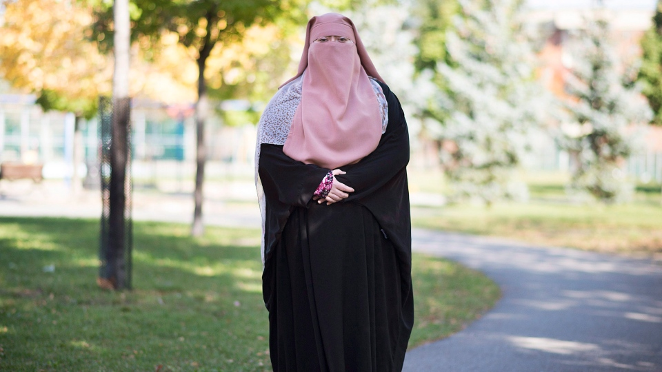 Warda Naili poses for a photograph at a park in Montreal, Saturday, October 21, 2017. (THE CANADIAN PRESS / Graham Hughes)
