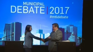 Valerie Plante and Denis Coderre shake hands following their English-language debate on Oct. 23, 2017