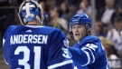 Toronto Maple Leafs centre Patrick Marleau (12) and goalie Frederik Andersen (31) celebrate their win over the Los Angeles Kings following the end of regulation time of NHL hockey action in Toronto on Monday, October 23, 2017. THE CANADIAN PRESS/Nathan Denette