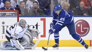 Los Angeles Kings goalie Jonathan Quick makes a save on Toronto Maple Leafs left wing James van Riemsdyk during first period NHL hockey action in Toronto on Monday, Oct. 23, 2017. (Nathan Denette / THE CANADIAN PRESS)