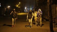 Kashmiri vigilantes patrol in Srinagar, India
