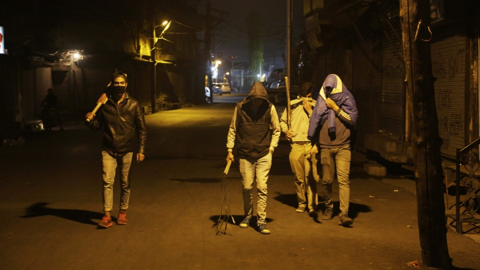 Kashmiri vigilantes patrol a street in Srinagar, India, on Sept 20, 2017. (Mukhtar Khan / AP)