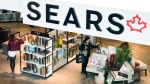 Shoppers enter and leave a Sears retail store in Toronto on Thursday, October 19, 2017. THE CANADIAN PRESS/Nathan Denette