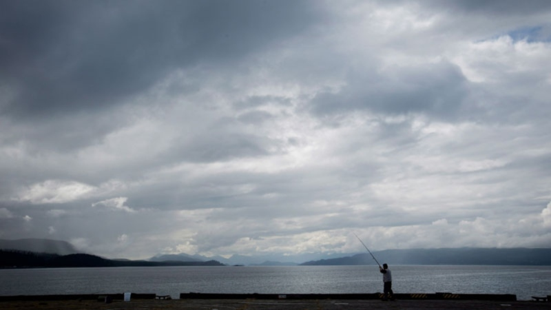 File photo: A man fishes on the end of a wharf in Sandspit, B.C., on Moresby Island in Haida Gwaii. THE CANADIAN PRESS/Darryl Dyck