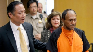 In this July 7, 2015 file photo, Jose Ines Garcia Zarate, right, is led into the courtroom by San Francisco Public Defender Jeff Adachi, left, and Assistant District Attorney Diana Garciaor, center, for his arraignment. (Michael Macor/San Francisco Chronicle via AP)