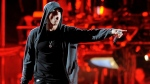FILE - In this April 15, 2012, file photo, Eminem performs at the 2012 Coachella Valley Music and Arts Festival in Indio, Calif.  (AP Photo/Chris Pizzello, File)