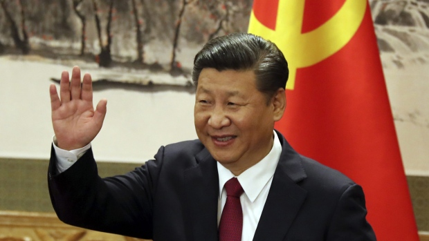 Chinese President Xi Jinping waves