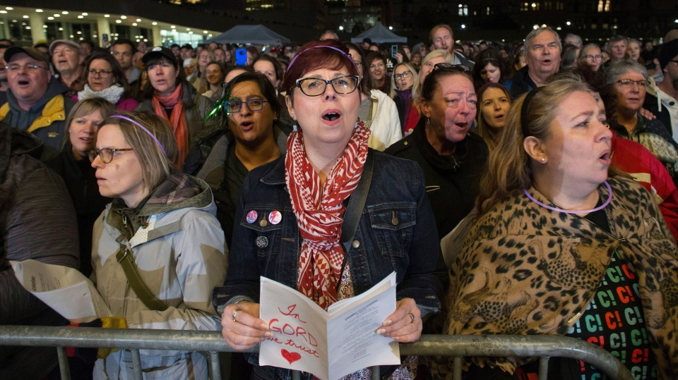 "Tragically Hip fans join Singalong Collective ""Choir Choir Choir!"" as they perform Tragically Hip songs to Hip fans gathered in Toronto's Nathan Phillips Square to pay tribute to the band's late singer Gord Downie, on Tuesday, October 24, 2017. THE CANADIAN PRESS/Chris Young"