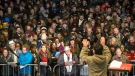 """Singalong Collective """"Choir Choir Choir!"""" performs Tragically Hip songs to Hip fans gathered in Toronto's Nathan Phillips Square to pay tribute to the band's late singer Gord Downie, on Tuesday October 24 , 2017. THE CANADIAN PRESS/Chris Young"""
