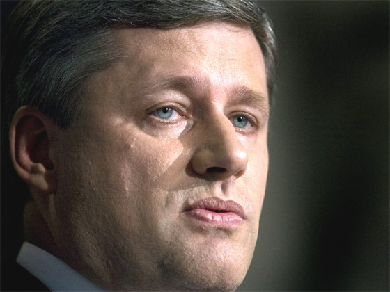 Prime Minister Stephen Harper talks with reporters at a news conference following Royal Assent in the Senate on Parliament Hill in Ottawa, June 22, 2007. (CP  / Tom Hanson)