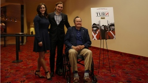 Former President George H.W. Bush, right, actress Heather Lind, left, and actor Seth Numrich, centre, in Houston, Texas, on March, 29, 2014. (Aaron M. Sprecher / Invision for AMC / AP Images)