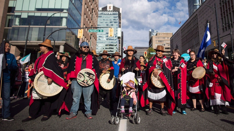 First Nations people wait for the Walk for Reconciliation to begin in Vancouver, B.C., on Sunday, Sept. 24, 2017. THE CANADIAN PRESS/Darryl Dyck