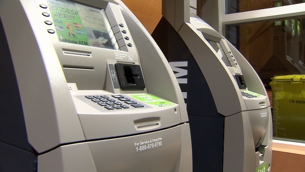 Woman using ATM in St. Boniface robbed