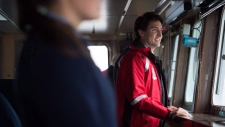 Prime Minister Justin Trudeau stands on the bridge of the Canadian Coast Guard ship Sir Wilfrid Laurier, during a tour of the harbour in Vancouver, B.C., on Monday Nov. 7, 2016. (THE CANADIAN PRESS / Darryl Dyck)