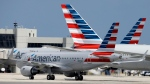 In this Wednesday, May 27, 2015, file photo, an American Airlines jet taxis to the gate at Miami International Airport, in Miami. (AP / Lynne Sladky)