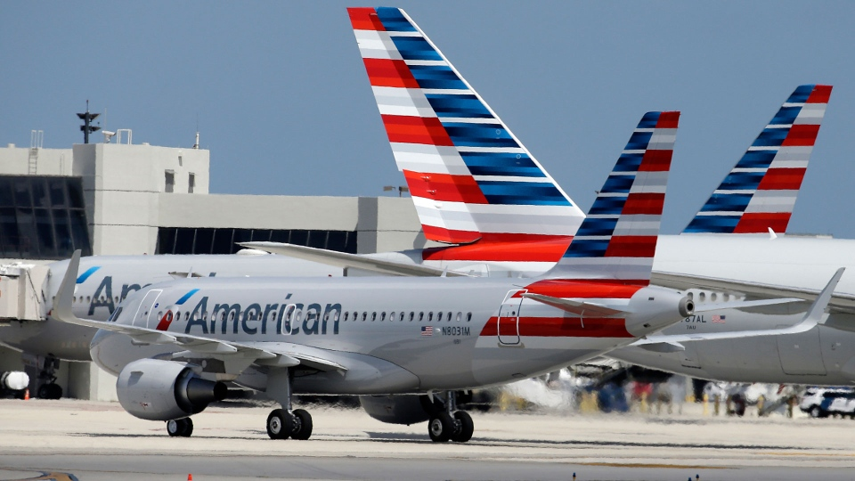 In this Wednesday, May 27, 2015, file photo, an American Airlines jet taxis to the gate at Miami International Airport, in Miami. (AP Photo/Lynne Sladky, File)