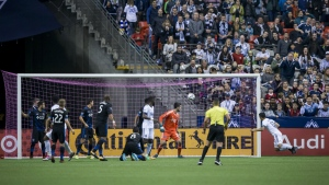 Vancouver Whitecaps' Fredy Montero, right, scores a goal against San Jose Earthquakes' goalkeeper Andrew Tarbell, third right, during the first half of an MLS playoff soccer game in Vancouver, B.C., on Wednesday, Oct. 25, 2017. (Darryl Dyck / THE CANADIAN PRESS)
