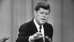 In this April 12, 1961 photo, President John F. Kennedy answers a question during his ninth presidential news conference in Washington. (AP Photo/RMB)