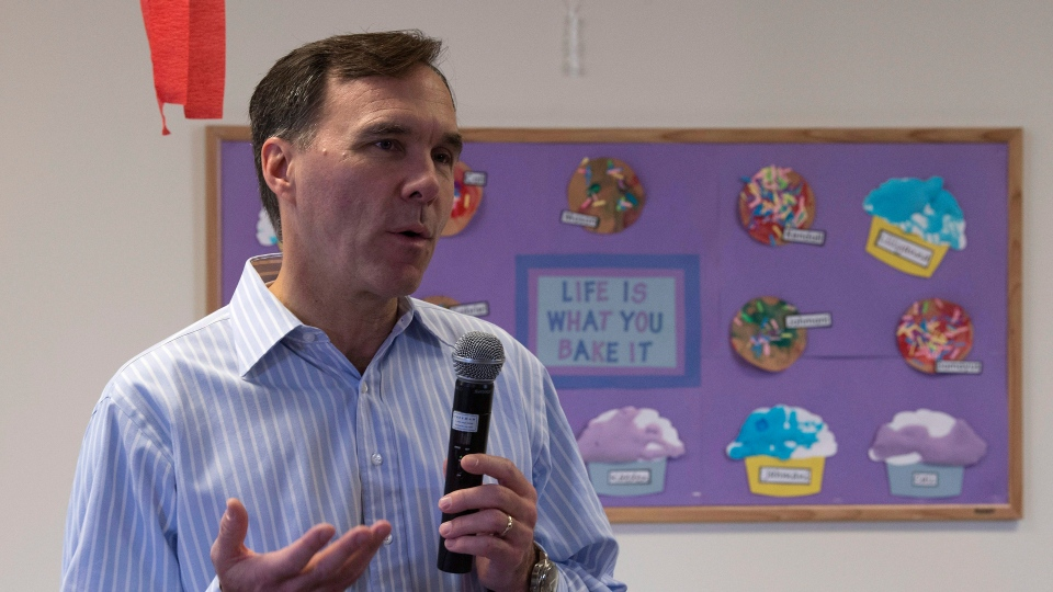 Minister of Finance Bill Morneau speaks with the media after touring a daycare centre for young mothers Wednesday October 25, 2017 in Ottawa. (THE CANADIAN PRESS/Adrian Wyld)