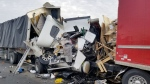 The driver of a transport truck was killed in a collision involving two other commercial vehicles on Highway 401 in Cambridge on October 27, 2017. (OPP Sgt. Kerry Schmidt/Twitter)