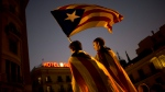 Pro-independence supporters carry an 'Estelada' or independence flag in downtown Barcelona Friday, Oct. 27, 2017. (AP / Francisco Seco)