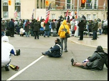 After spending the night outside the U.S. embassy, many Toronto Tamils rested briefly on the ground. The protest is expected to continue today.