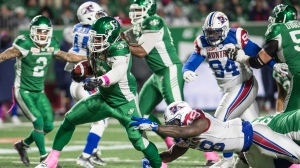 Saskatchewan Roughriders running back Trent Richardson (33) breaks a tackle as he runs the ball down field during second half CFL football action against the Montreal Alouettes in Regina on Friday, October 27, 2017. THE CANADIAN PRESS/Rick Elvin