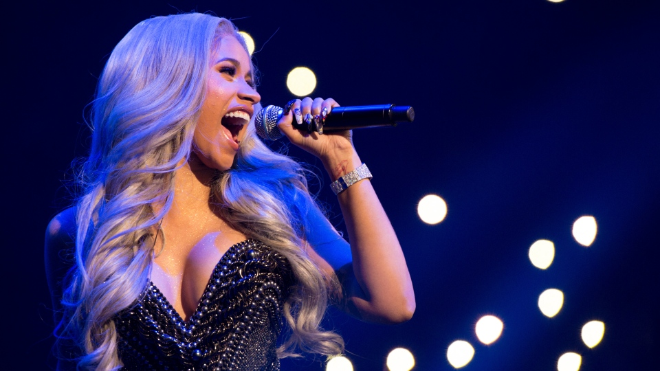 In this Oct. 26, 2017 file photo, recording artist Cardi B performs at Power 105.1's Powerhouse at Barclays Center in New York. (Photo by Scott Roth/Invision/AP)