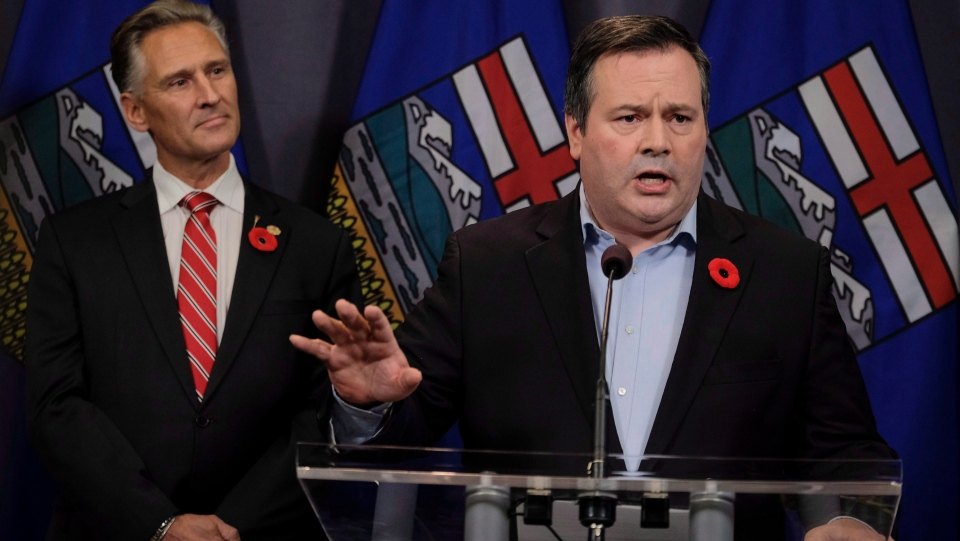 United Conservative Party leader Jason Kenney speaks to reporters the day after being elected the first official leader of the new party as MLA Dave Rodney looks on in Calgary, Alta., Sunday, Oct. 29, 2017. (THE CANADIAN PRESS/Jeff McIntosh)