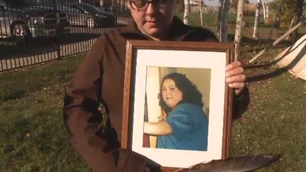 Trish Johnson holds a photo of her sister Cheryl-Anne who died when she was 23-years-old.