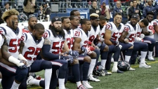 Houston Texans kneel during anthem