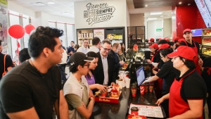 Customers place their orders at the grand opening of a Tim Hortons restaurant in San Pedro Garza Garcia, Mexico, on Oct. 27, 2017. (RBI)