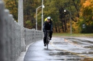 A cyclist rides along the Rideau Canal pathway in the rain in Ottawa on Monday, Oct. 30, 2017.  (Justin Tang/THE CANADIAN PRESS)