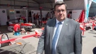 Montreal Mayor Denis Coderre walks through the paddock at the Montreal Formula ePrix electric car race, in Montreal on Friday, July 28, 2017. THE CANADIAN PRESS/Ryan Remiorz