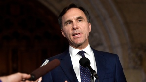 Minister of Finance Bill Morneau speaks to reporters in the Foyer of the House of Commons on Parliament Hill following Question Period, in Ottawa on Thursday, Oct. 26, 2017. (THE CANADIAN PRESS / Justin Tang)