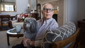 Max Morton sits with his dog Barney at his home in Richmond, B.C., on Monday, Oct. 30, 2017. (Darryl Dyck / THE CANADIAN PRESS)