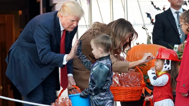 Donald and Melania Trump hand out Halloween treat