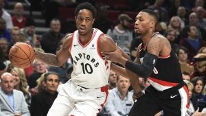 Toronto Raptors guard DeMar DeRozan drives to the basket on Portland Trail Blazers guard Damian Lillard during the first quarter of an NBA basketball game in Portland, Ore. on Monday, Oct. 30, 2017. (AP / Steve Dykes)