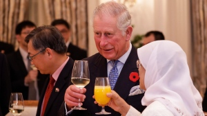 Britain's Prince Charles, center, offers a toast to Singapore's President Halimah Yacob during a state banquet held at the Istana or Presidential Palace in Singapore, Tuesday, Oct. 31, 2017. (AP Photo/Yong Teck Lim)
