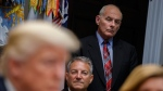 White House chief of staff John Kelly listens as U.S. President Donald Trump speaks at the White House, on Oct. 31, 2017. (Evan Vucci / AP)