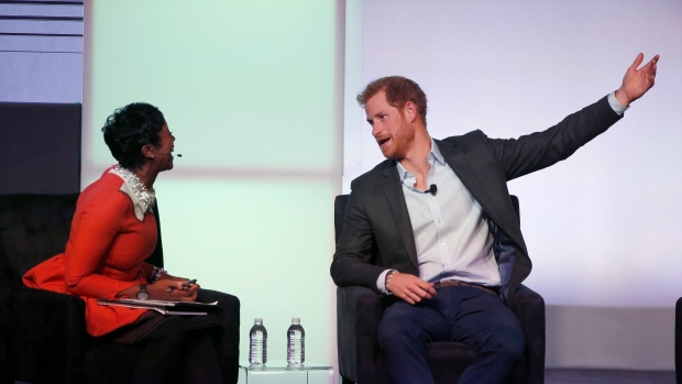 Britain's Prince Harry, right, responds to a question from Mellody Hobson during the second session of the Obama Foundation Summit, Tuesday, Oct. 31, 2017. (AP Photo/Charles Rex Arbogast)